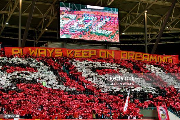 RB Leipzig fans cheer on their team during the Europa League quarter final first leg football match RB Leipzig vs Olympique de Marseille at the Red...