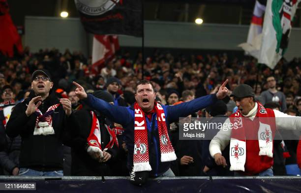 Leipzig fans enjoy the atmosphere during the UEFA Champions League round of 16 second leg match between RB Leipzig and Tottenham Hotspur at Red Bull...