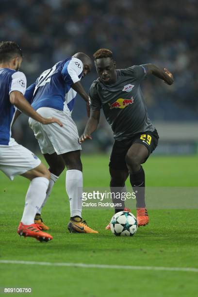 Leipzig forward Jean Kevin Augustin from France tries to pass through FC Porto's midfielder Danilo Pereira from Portugal during the match between FC...