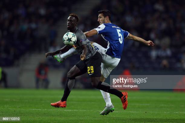 Leipzig forward Jean Kevin Augustin from France vies with FC PortoÕs defender Ivan Marcano from Spain for the ball possession during the match...