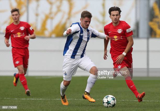 Leipzig forward Nicolas Gerrit Kuhn from Germany with FC Porto midfielder Joao Lameira in action during the UEFA Youth League match between FC Porto...