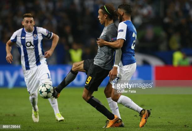 Leipzig forward Yurary Poulsen from Denmark with FC Porto defender Diego Reyes from Mexico in action during the UEFA Champions League match between...