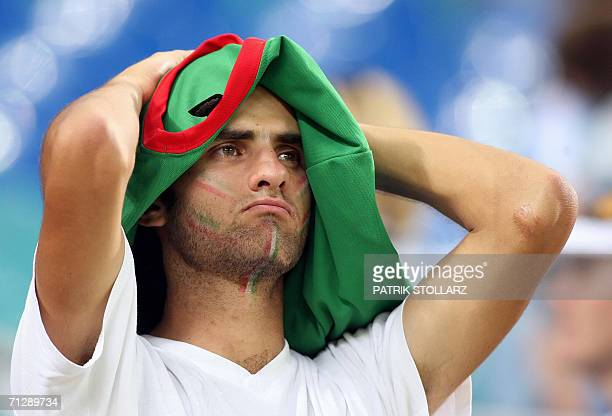 A Mexican supporter looks dejected at the end of the World Cup 2006 round of 16 football game Argentina vs Mexico 24 June 2006 at Leipzig stadium...