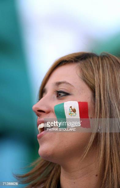Mexican supporter with her national flag painted on her cheek smiles as she waits for the beginning of the World Cup 2006 round of 16 football game...