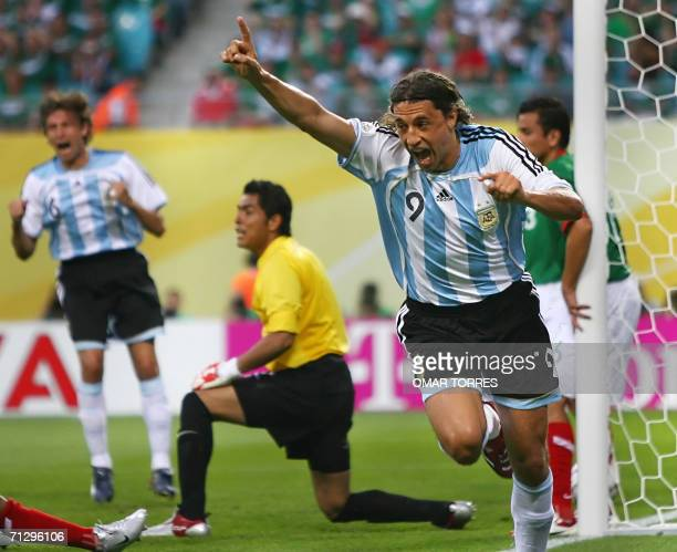 Argentinian forward Hernan Crespo celebrates next to Mexican goalkeeper Oswaldo Sanchez after Mexican forward Jared Borgetti scored an own goal...