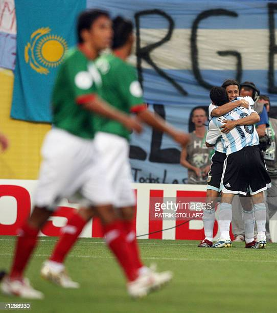 Argentinian forward Hernan Crespo is congratulated by Argentinian midfielder Juan Roman Riquelme after Mexican forward Jared Borgetti scored an own...