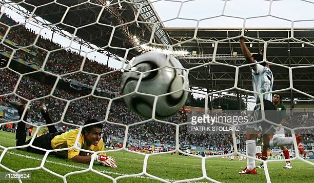 Argentinian forward Javier Saviola celebrates next to Argentinian goalkeeper Roberto Abbondanzieri after Mexican forward Jared Borgetti scored an own...