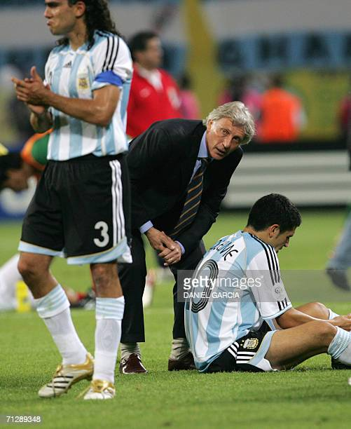 Argentinian head coach Jose Pekerman gives instructions to Argentinian midfielder Juan Roman Riquelme prior to the extratime of the World Cup 2006...