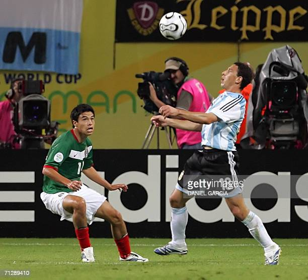 Argentinian midfielder Maxi Rodriguez eyes the ball prior to a volley to score the second goal despite for his team during the extra time of World...