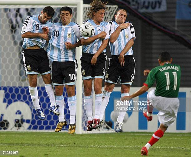 Mexican defender Ramon Morales shots a free kick in front of Argentinian defensive wall during the World Cup 2006 round of 16 football game Argentina...