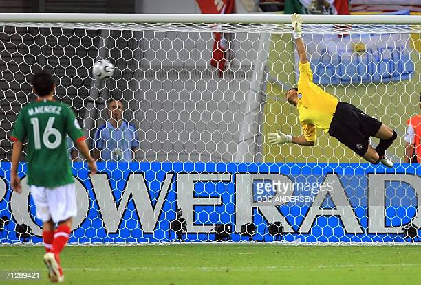 Mexican goalkeeper Oswaldo Sanchez dives vainly to save a kick by Argentinian midfielder Maxi Rodriguez during the World Cup 2006 round of 16...