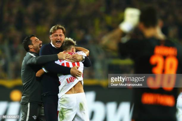 Leipzig Head Coach / Manager Ralph Hasenhuttl celebrates victory with Kevin Kampl after the Bundesliga match between Borussia Dortmund and RB Leipzig...