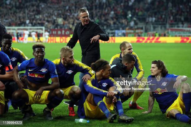 Leipzig Head Coach Ralf Rangnick celebrates with his team after winning the DFB Cup match between FC Augsburg and RB Leipzig at WWK-Arena on April...