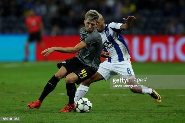 Leipzig midfielder Kevin Kampl from Slovenia vies with FC PortoÕs forward Yacine Brahimi from Algeria for the ball possession during the match...