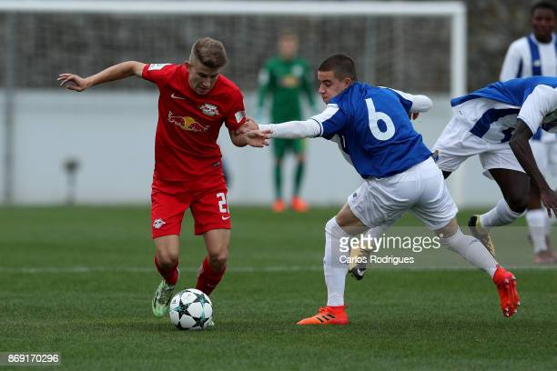 Leipzig midfielder Lucas Schmidt from Germany tries to escape FC Porto forward Paulo Estrela from Portugal during the match between FC Porto v RB...