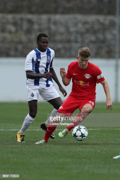 Leipzig midfielder Lucas Schmidt from Germany tries to escape FC Porto forward Madi Queta from Portugal during the match between FC Porto v RB...