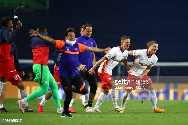 Leipzig players and staff celebrate following their team's victory in the UEFA Champions League Quarter Final match between RB Leipzig and Club...
