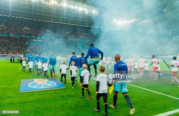 TOPSHOT Leipzig's and Porto's players arrive on the pitch prior to the UEFA Champions League group G football match RB Leipzig v FC Porto in Leipzig...