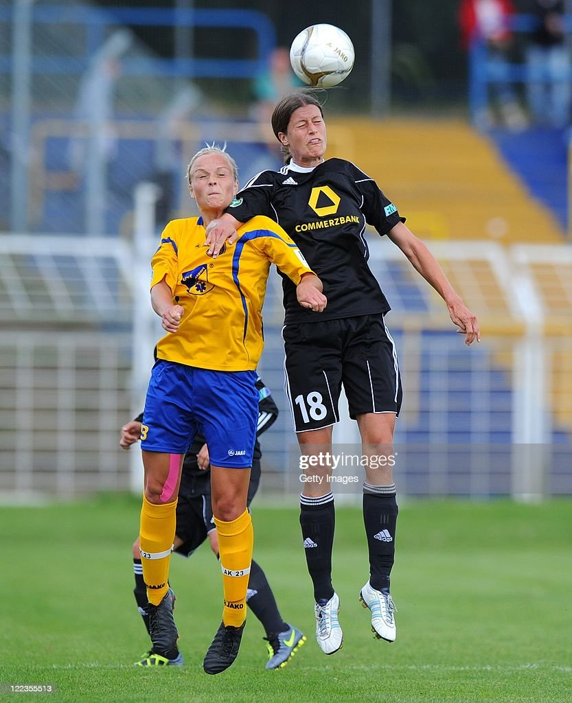 Leipzig's Ann-Katrin Schinkel (L) jumps for a header with Kerstin Garefrekes of Frankfurt during the Women's Bundesliga match between 1. FC Lok Leipzig and 1. FFC Frankfurt at the Bruno-Plache-Stadium on August 28, 2011 in Leipzig, Germany.