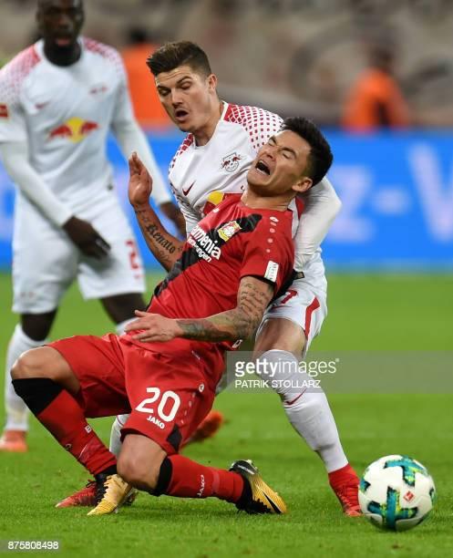 Leipzig's Austrian defender Marcel Sabitzer and Leverkusen's Chilean midfielder Charles Aranguiz vie for the ball during the German First Division...
