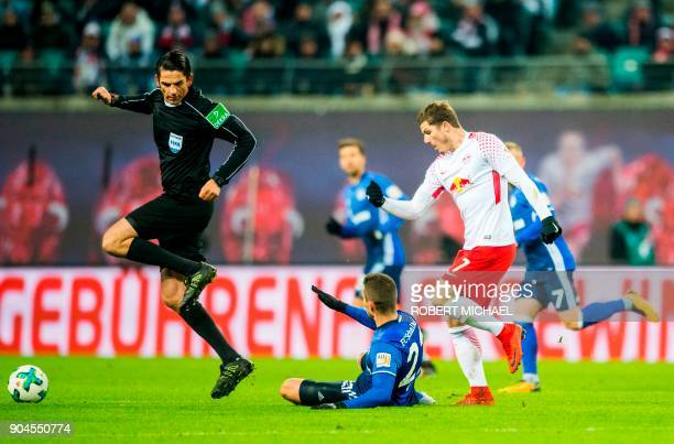 Leipzig´s Austrian forward Marcel Sabitzer and Schlake´s Croatian midfielder Marko Pjaca vie for the ball next to referee Deniz Aytekin during the...