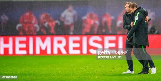 Leipzig´s Austrian head coach Ralph Hasenhuettl and Bremen´s head coach Florian Kohfeldt react after the German first division Bundesliga football...