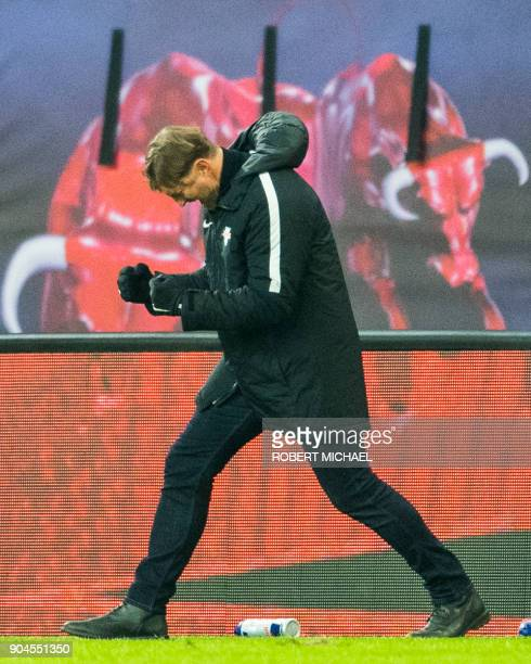 Leipzig´s Austrian head coach Ralph Hasenhuettl celebrates after the German first division Bundesliga football match between RB Leipzig and FC...