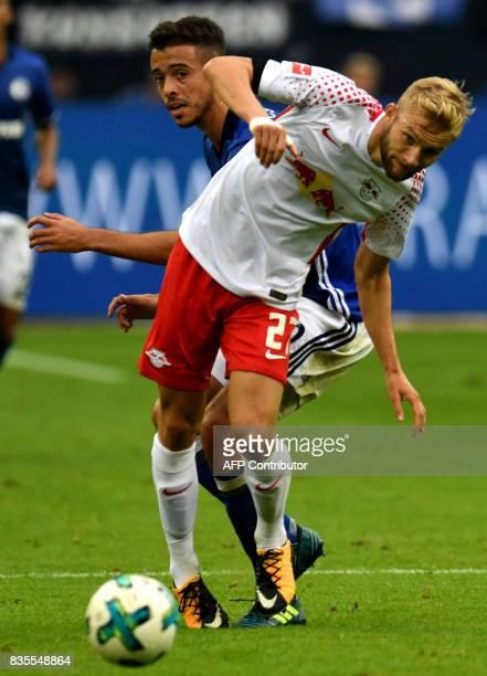 Leipzig's Austrian midfielder Konrad Laimer and Schalke's Argentinian forward Franco di Santo vie for the ball during the German First division...