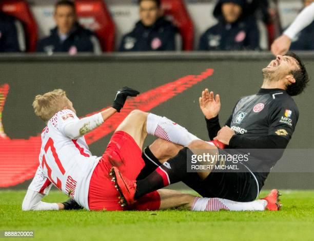 Leipzig´s Austrian midfielder Konrad Laimer fouls Mainz' Italian defender Giulio Donati during the German first division Bundesliga football match of...