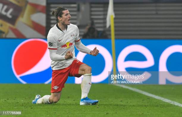 Leipzig's Austrian midfielder Marcel Sabitzer celebrates after scoring the 21 during the UEFA Champions League Group G football match RB Leipzig vs...