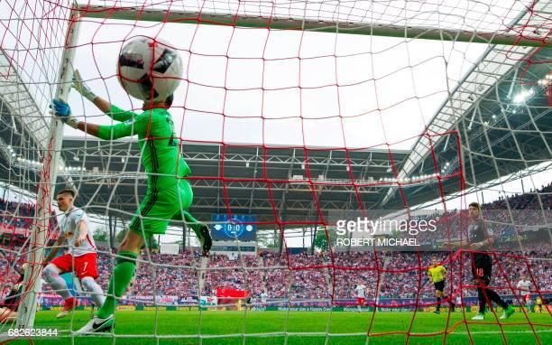 Leipzig's Austrian midfielder Marcel Sabitzer celebrates after scoring the 1-0 against Bayern Munich's goalkeeper Tom Starke during the German first...