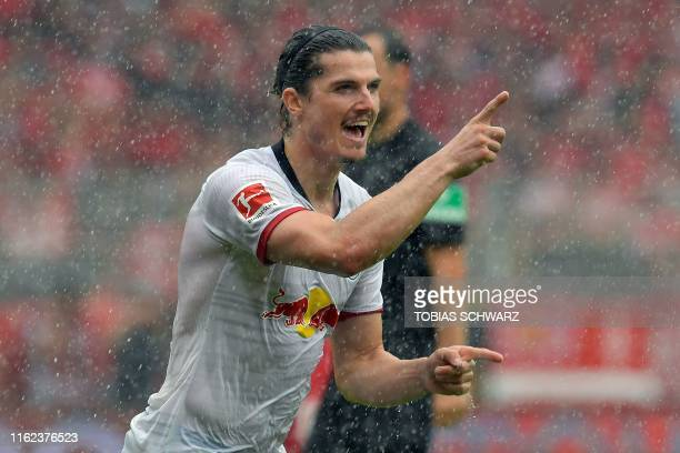 Leipzig's Austrian midfielder Marcel Sabitzer celebrates scoring the 02 goal during the German first division Bundesliga football match FC Union...