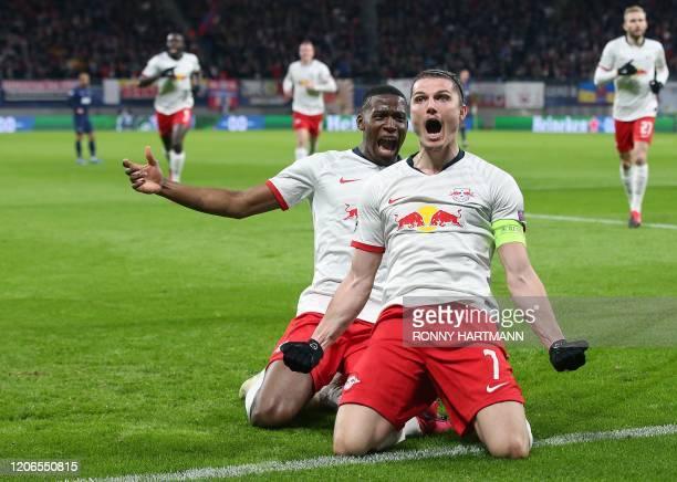 Leipzig's Austrian midfielder Marcel Sabitzer celebrates scoring the 1-0 lead with French defender Nordi Mukiele during the UEFA Champions League...