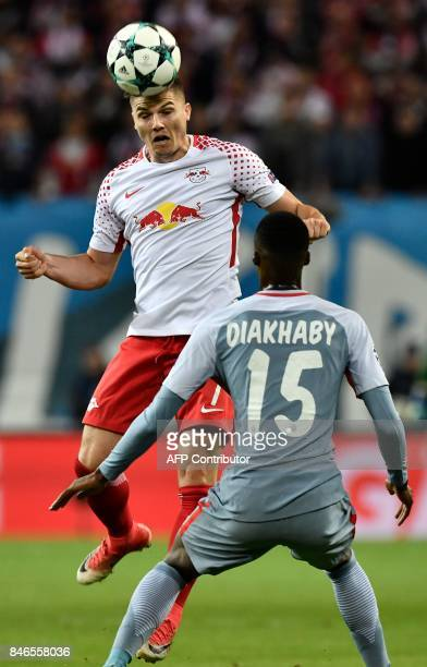 Leipzig's Austrian midfielder Marcel Sabitzer heads the ball next to Monaco's French forward Adama Diakhaby during the Champions League group G...