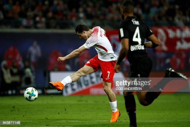 Leipzig's Austrian midfielder Marcel Sabitzer shoots to score during the German first division Bundesliga football match between Bayer Leverkusen vs...