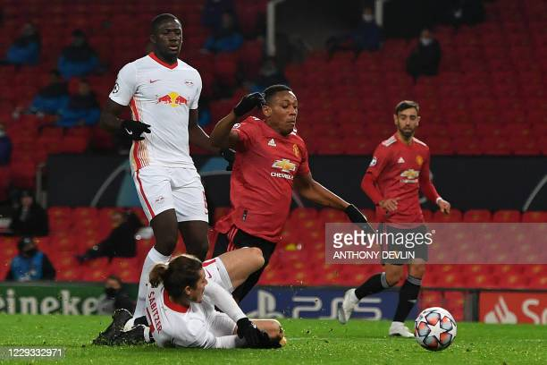 RB Leipzig's Austrian striker Marcel Sabitzer fouls Manchester United's French striker Anthony Martial to concede a penalty during the UEFA Champions...