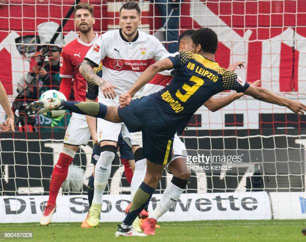 Leipzig's Brazilian defender Bernardo tries a shot watched by Stuttgart's goalkeeper RonRobert Zieler and forward Daniel Ginczek during the German...