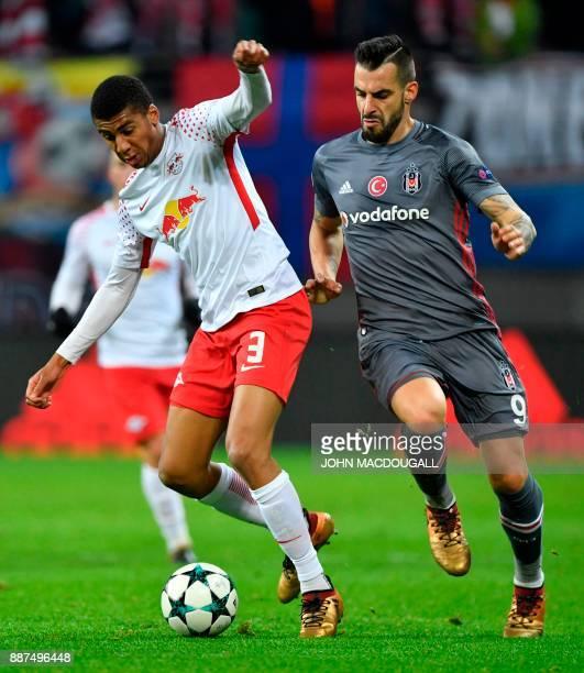 Leipzig's Brazilian defender Bernardo vies with Besiktas' Spanish forward Alvaro Negredo during the UEFA Champions League group G football match RB...