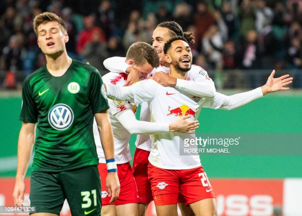 Leipzig´s Brazilian forward Matheus Cunha celebrates scoring the first goal with his teammate Danish forward Yussuf Poulsen defender Lukas...