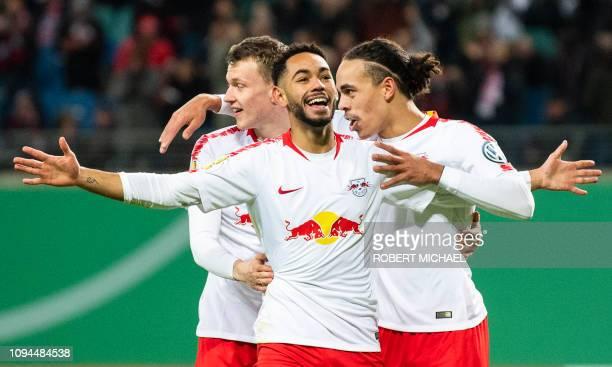 Leipzig´s Brazilian forward Matheus Cunha celebrates scoring the first goal with his teammate Danish forward Yussuf Poulsen and defender Lukas...
