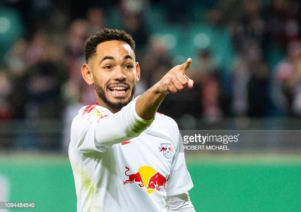 Leipzig´s Brazilian forward Matheus Cunha celebrates scoring the first goal during the German Cup last 16 football match RB Leipzig v VfL Wolfsburg...