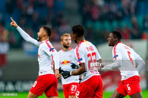 Leipzig's Brazilian forward Matheus Cunha celebrates with teammates after scoring during the UEFA Europa League Group B football match between RB...