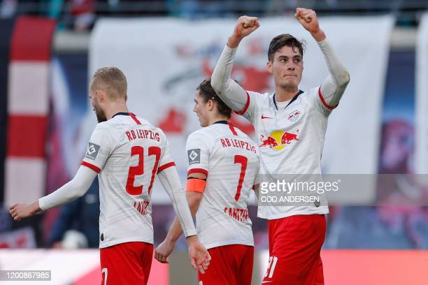 Leipzig's Czech forward Patrik Schick celebrates scoring the 20 goal with his teammates during the German first division Bundesliga football match RB...