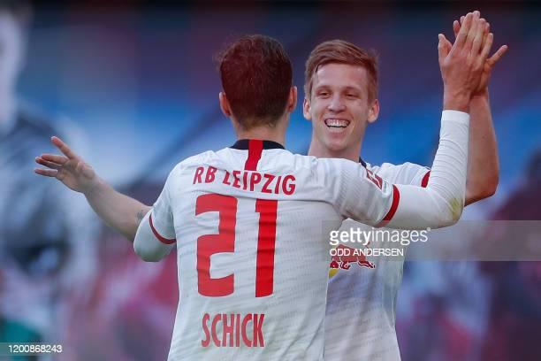 Leipzig's Czech forward Patrik Schick celebrates scoring the 2-0 goal with his team-mate Spanish midfielder Dani Olmo during the German first...