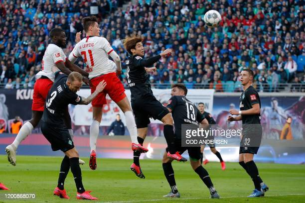 Leipzig's Czech forward Patrik Schick heads the ball to score the 20 goal during the German first division Bundesliga football match RB Leipzig vs SV...