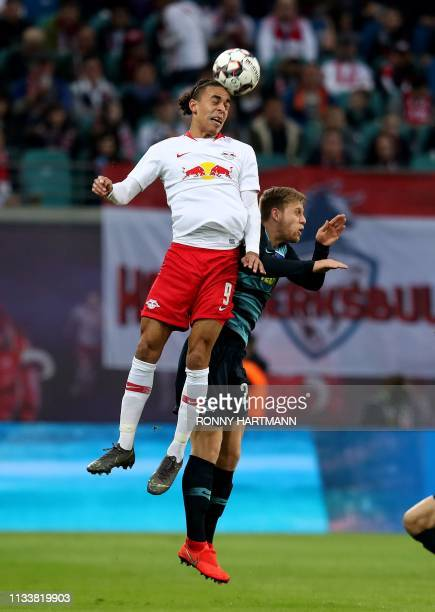 Leipzig's Danish forward Yussuf Poulsen and Berlin's German midfielder Arne Maier vie for the ball during the German first division Bundesliga...