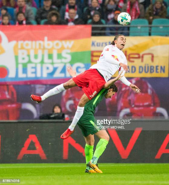 Leipzig´s Danish forward Yussuf Poulsen and Bremen´s Serbian defender Milos Veljkovic vie for the ball during the German First division Bundesliga...