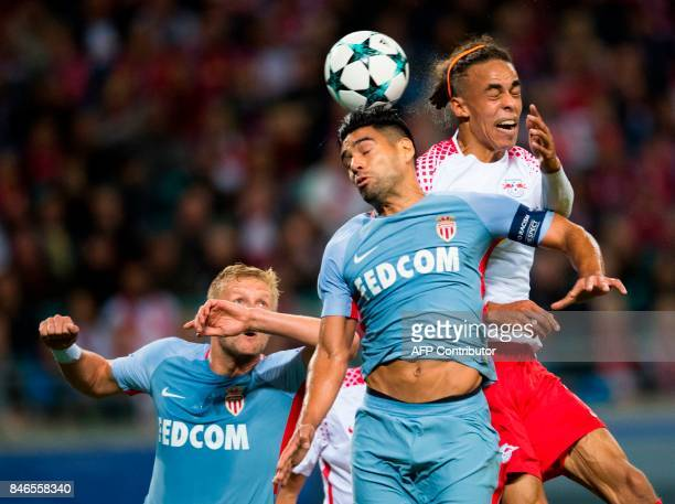 Leipzig´s Danish forward Yussuf Poulsen and Monaco's Colombian forward Radamel Falcao vie for the ball during the UEFA Champions League group G...