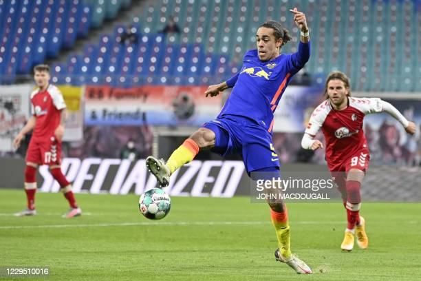 Leipzig's Danish forward Yussuf Poulsen controls the ball during the German first division Bundesliga football match between RB Leipzig and SC...
