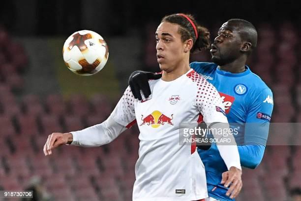 Leipzig's Danish forward Yussuf Poulsen controls the ball with Napoli's French defender Kalidou Koulibaly during the UEFA Europa League football...